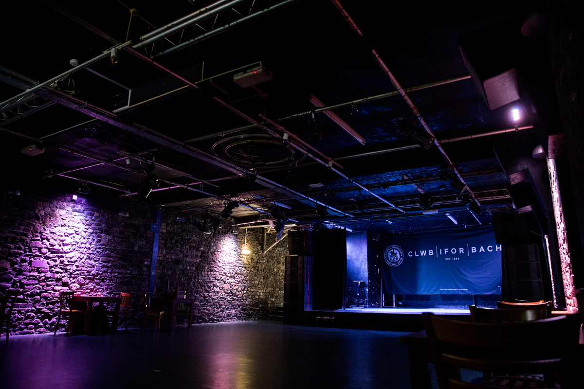 A photograph of the interior of Clwb Ifor Bach with stage for live music