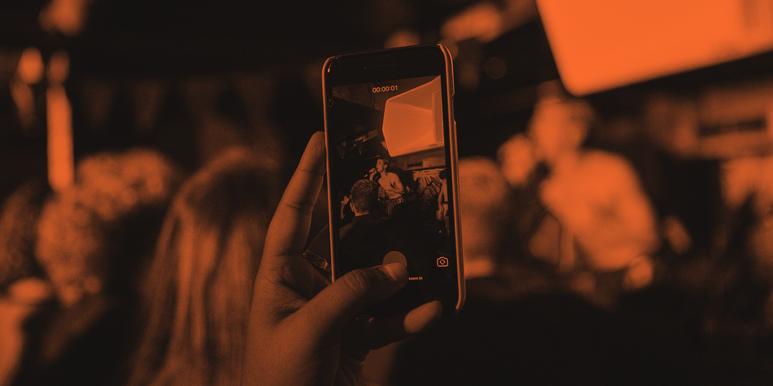 Photo of a phone at a live gig
